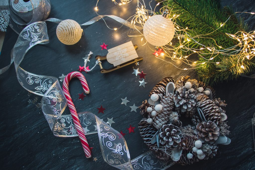 A high angle view of Christmas decorations and lights on the wooden table